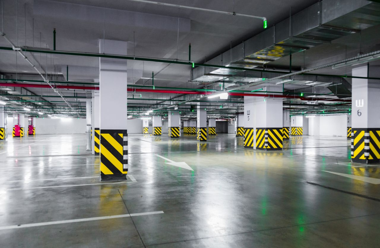 Empty underground parking garage. industrial background